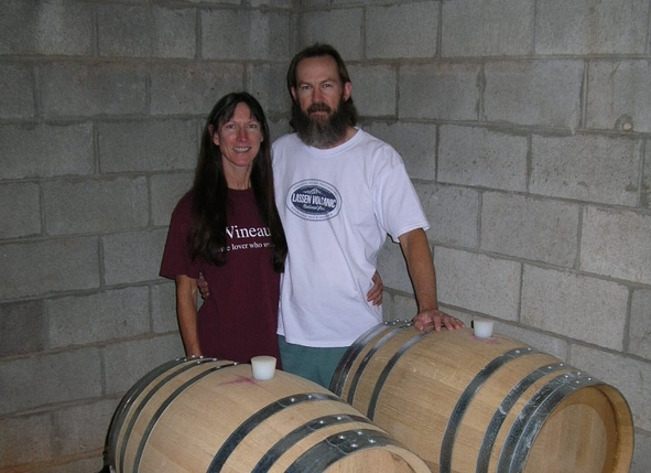 The winegrowers posing with barrels
